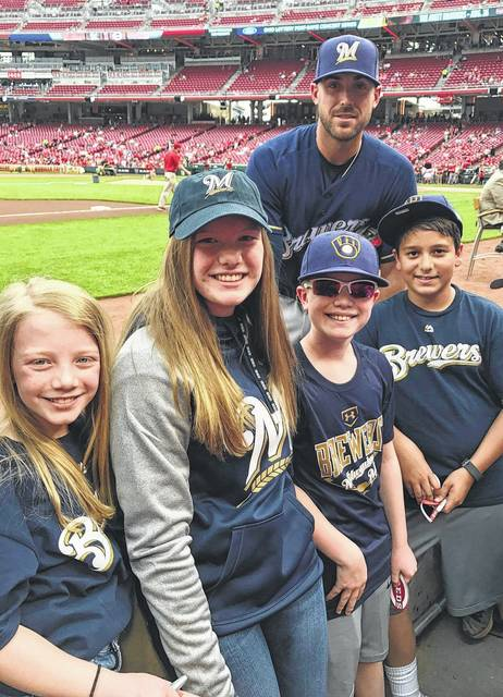 Milwaukee Brewers third baseman Travis Shaw (back) spent time with some Washington C.H. youth before the game against the Cincinnati Reds Sunday, April 16, 2017. (l-r); Maggi, Halli and John Wall and Jack Mead. Shaw celebrated his 27th birthday Sunday hitting a solo home run in the Brewers' 4-2 win over the Reds.