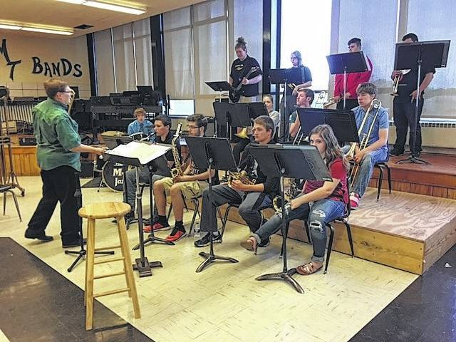 The Miami Trace High School Jazz Band was visited by Linda Landis, principal trombonist for the Columbus Jazz Orchestra, on Friday. Her clinic to the students included tips for improvisation and the importance of musical heritage, as well as remaining true to oneself. She is pictured with the students during her visit.