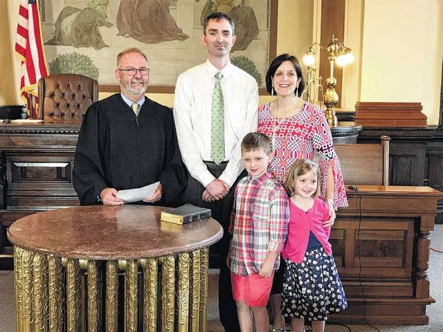 Aaron Coole (center), who was appointed by the Fayette County Republican Central Committee as the new Fayette County Auditor following the retirement of Mike Smith, was recently sworn in by Fayette County Common Pleas Court Judge Steven Beathard (left). Pictured with Coole are his wife, Colleen Coole, and his children Micah and Jane Ellen Coole.