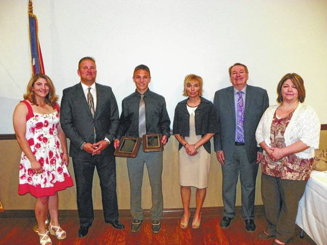 Blake Pittser, third from left, was announced Monday as the 2017 Christman Award recipient. From left to right, 2016 Christman Award winner Wendy Hawk, Blake's father and coach Rob Pittser, Blake's mother Kim Pittser, Gary Brock of the Washington Kiwanis Club, and Record-Herald General Manager Katie Bottorff.