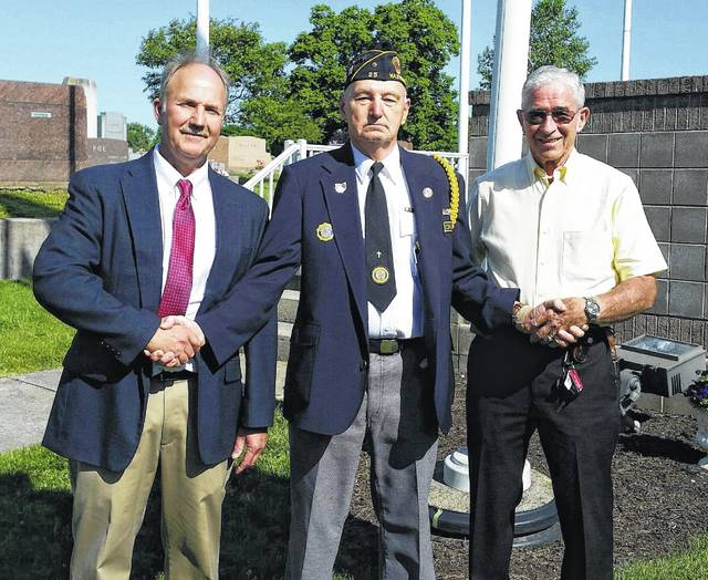 A Memorial Day ceremony was held at Washington Cemetery on Monday morning to honor the fallen soldiers. Pictured (left to right): speaker at the ceremony, Paul LaRue; Honor Guard member David Frederick and minister for the First Baptist Church, Ed Gault.