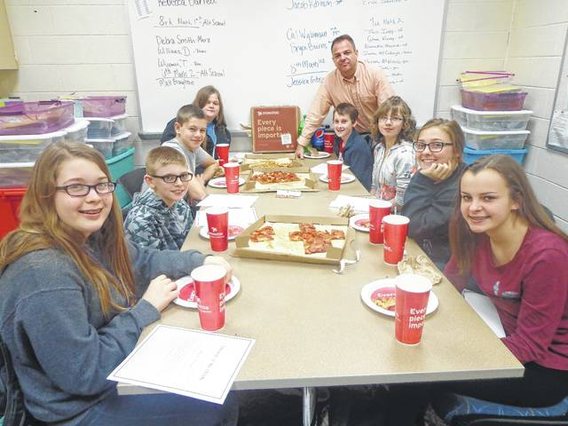 "Donatos recently provided pizza to these students at Washington Middle School as they celebrated ""Pizza with the Principals."" This is in appreciation for their selection as Students of the Month for April. They are chosen by their teachers because of the outstanding example they set for their peers in such areas as academic effort, good work ethic, kindness to others, and service to their school. Pictured from left: Meadow Cooper, Ian Rheinscheld, Rowdy Hay, Katie Slavens, (Mr. Montgomery, Assistant Principal) Josh Cartwright, Kayla Sines, Emma Funari and Jordan Montgomery."