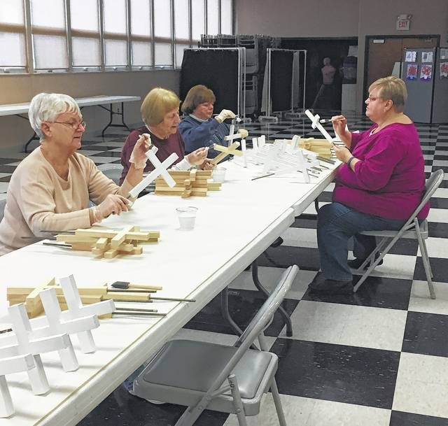 Members of Grace United Methodist Church gather to paint over 400 handmade crosses.