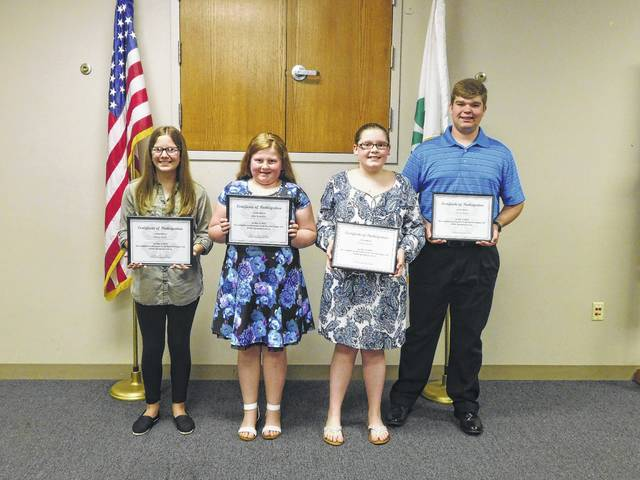 On May 3, two members of Charm-N-Farm 4-H club competed in the Fayette County 4-H Public Speaking Contest. Lilly Hamilton recited the 4-H pledge and Trevor Minyo delivered a speech on the importance of sports safety. All members who participated were able to advance their public speaking skills by speaking in front of a crowd. Pictured (L to R): Kelsey Pettit (Top Performers), Lilly Hamilton (Charm-N-Farm), Jenna Goddard (Fayette Farm Life), and Trevor Minyo (Charm-N-Farm).