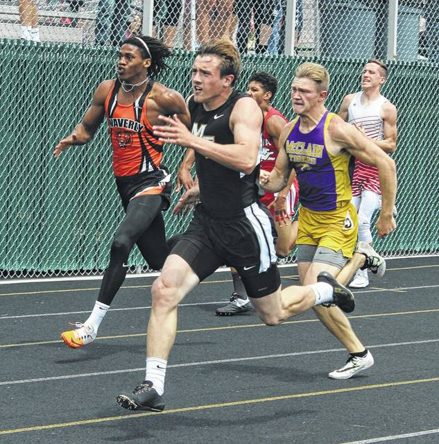 Miami Trace senior Drake Litteral leads the field in the final 50 meters of the 200-meter dash at the Division II Regional track meet Saturday, May 27, 2017 at Athens High School. Litteral won this event in a time of 22.56. Earlier in the afternoon, Litteral placed a very close second in the 100-meter dash finals, qualifying to State in two events. Also pictured are Faheem Gilbert of Waverly at left and Tristan Pitzer of McClain, at right. They placed second and third, respectively, to advance to State in the 200-meter dash.