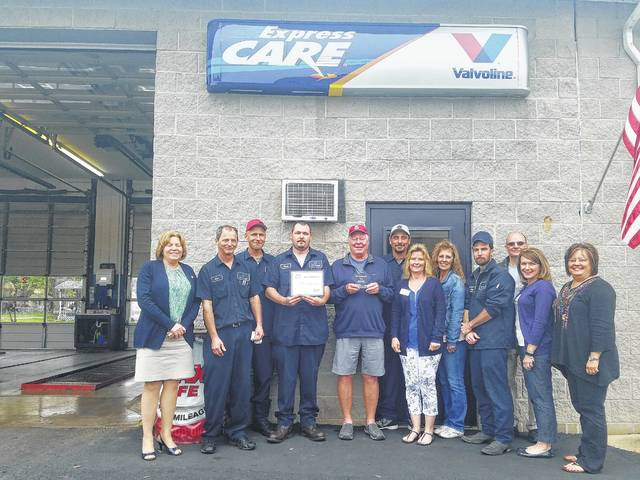 Members of the Fayette County Chamber of Commerce recently made a plaque presentation to employees of EZ Oil Change for being in business for 25 years.