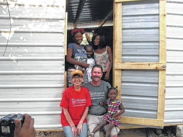 Hospice of Fayette County Pastor Jeff Davis and volunteer Glenna Rowe are pictured with a Haitian family receiving a home.