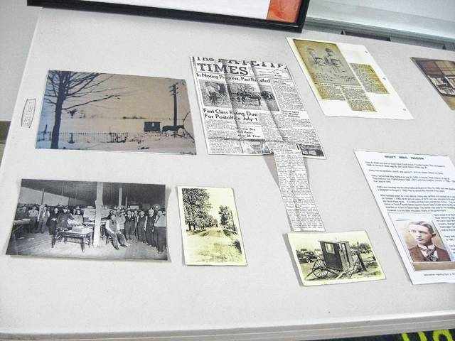 A display was shared by Glenn Rankin which included pictures looking inside the old post offices and memorabilia from those old post offices and the early post masters.