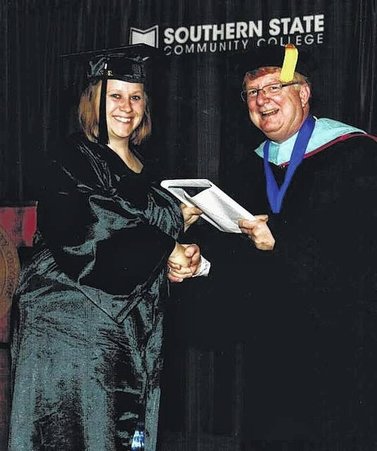 Jessica Ward, daughter-in-law of Melvin and Julie Ward, recently graduated from Southern State Community College in early May with an associate's of science degree. She is pictured with SSCC president Kevin Boys on her graduation day.
