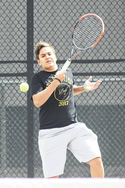 Miami Trace senior Juan Diego Navas returns a shot during a practice session with teammate Seth Leach Wednesday afternoon. Navas will compete in the 98th annual State tennis tournament Friday in Mason.