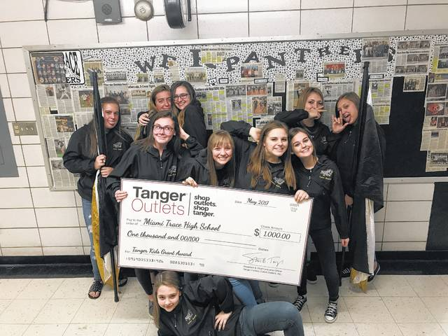 The Miami Trace Color Guard recently thanked the TangerKids Grant program for their support. The color guard will be able to purchase custom spirit flags with the Miami Trace logo to use for parades, community events, and the pregame show during football season with the funds provided by the grant.