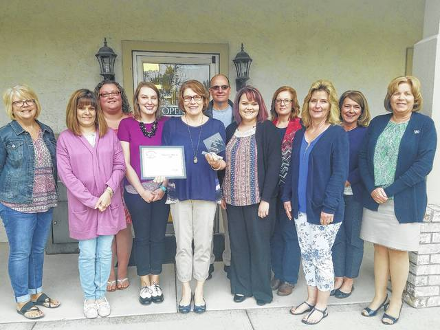 Members of the Fayette County Chamber of Commerce recently made a plaque presentation to Vanessa L. Blevins CPA for being in business for 25 years.