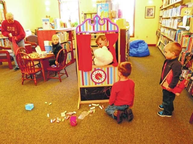Kids at Jeffersonville Branch Library enjoyed their new puppet stage. The kids so enjoyed playing with the puppets, writing their name and drawing on the chalkboard and playing with the clock.