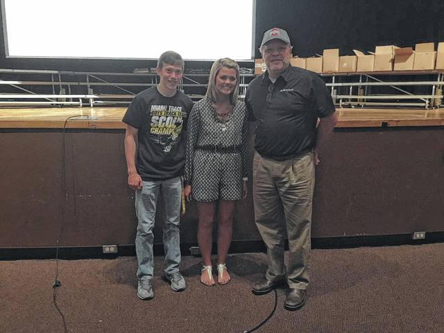 Gusweiler recently awarded two $1,000 scholarships to Miami Trace FFA students Nicholas Elrich and Marissa Sheets. They are pictured here with Mark Bottorff, sales and leasing consultant.