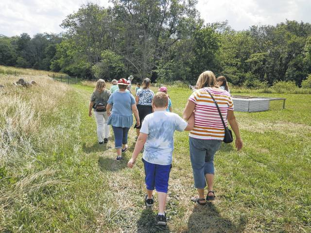 As a bonus, the group was allowed to tour a neighbor's dairy farm where they pet and fed cows of all ages.