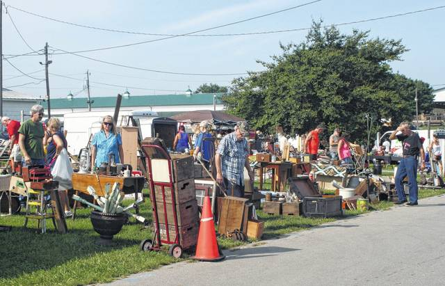 Customers browse numerous outdoor booths at the Scott Antique Markets Antique Extravaganza in Fayette County.