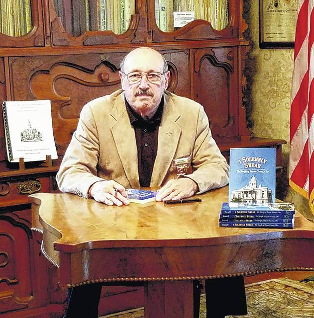 """Bob Russell, former lieutenant with the Fayette County Sheriff's Office, recently wrote his second book, """"I Solemnly Swear."""""""