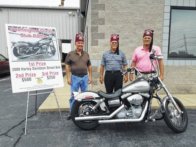 The Washington Shrine Club recently announced a fundraising raffle for the community to both support the club and enter to win a 2009 Harley Davidson Street Bob (pictured). Tickets are $25 a piece or five for $100 and can be purchased from any Washington Shrine Club member, at Hartley Oil or at Doug Marine Motors. Pictured (L to R): Washington Shrine Club members Steve Simpson, Benny Jamison and Sonny Kearns.