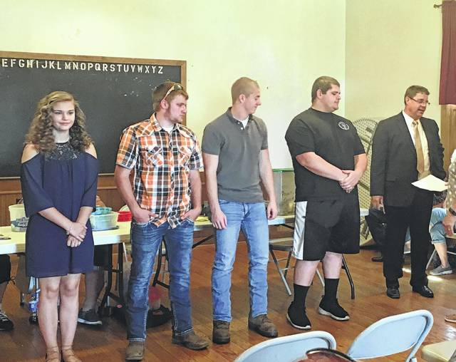 Recipients of scholarships from the Dragin' Angels from left to right: Madison Knisley, Timothy Hunter Moore, Liam Downing, Kyle Moore and the principal of the Fayette Christian School, accepting on behalf of Elizabeth Garren. Justin Jones and Victoria Jones were not present for picture.