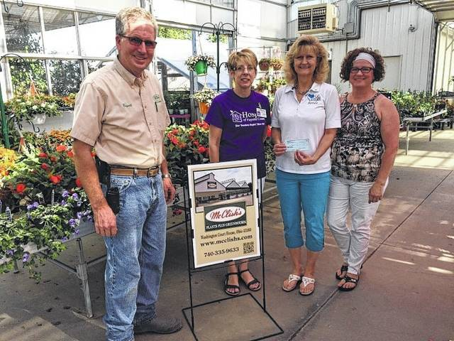 "Following a successful ""Grow Our Community Day,"" McClish's Plants Plus Greenhouses donated over $1,100 in total. Pictured (L to R): Brent McClish, Lynda Wilt with Hospice of Fayette Co., Barbara Fox with LIFE Pregnancy Center and Shawn Lachat with LIFE Pregnancy Center."