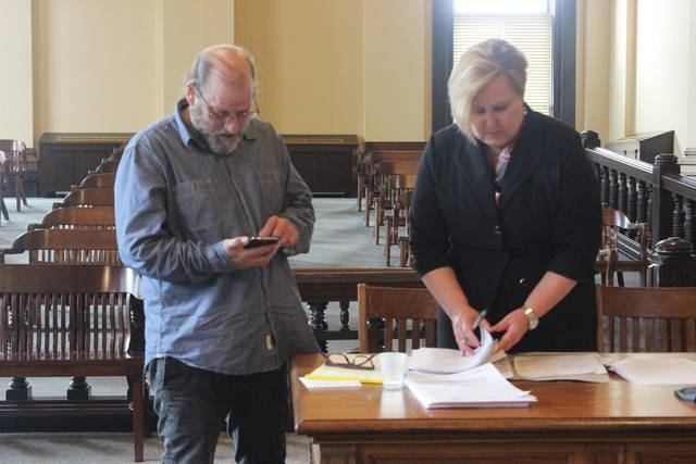 Christoper A. Haddick, left, with attorney Kathryn Hapner, in the Fayette County Court of Common Pleas Tuesday awaiting the jury's verdict.