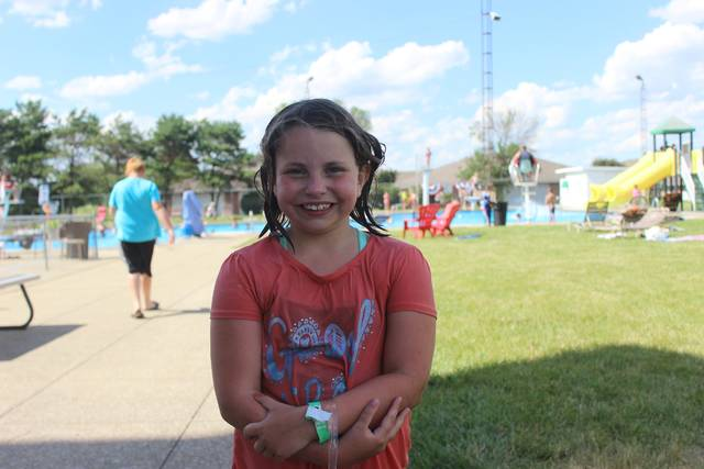 """Aubrey Kinzer, age 8, learned to officially swim at the Jeffersonville Community Pool last summer. """"It's fun. It's like the only time you get to get wet and play games,"""" said Kinzer."""