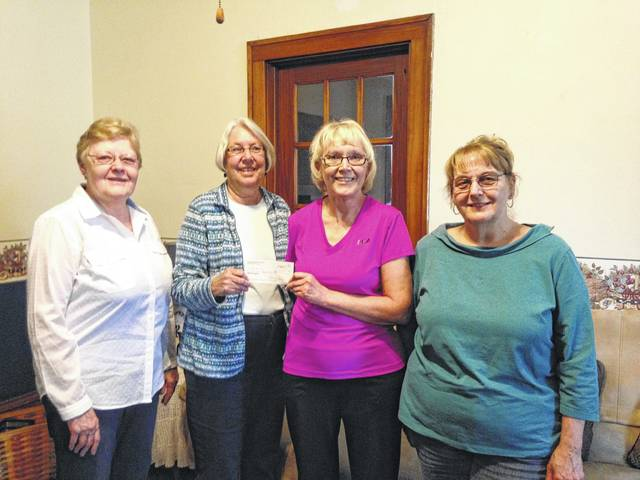 Members of Court House Quilters present a donation from their 2017 quilt show to The Brick House. Left to right are Mary Jo Wall, Beth Foster, Christy Dunlap accepting the donation, and Colleen Downing.