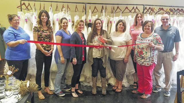 Ambassadors from the Fayette County Chamber of Commerce recently welcomed Rustique Formals, located at 147 E. Court St., with a ribbon cutting ceremony.