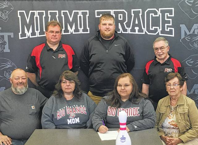 Tara Miller, front row, third from left, signs a letter of intent to attend Rio Grande University beginning in August. With Miller for the occasion are (front, l-r); her parents, Jimmy and Betsy Miller and her grandmother, Betty Roberts; (back, l-r); Rio Grande head bowling coach Brett Little, Miami Trace girls bowling coach Kaleb Taylor and assistant Rio Grande bowling coach, Phil Karl.
