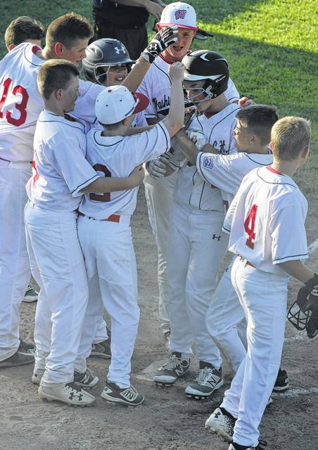 Tyler Tackage, third from right, is greeted at home plate by Washington C.H. all-stars teammates after hitting a home run to lead off the bottom of the fourth inning of a District Eight tournament game against Enon Thursday, June 29, 2017 at the Little League complex on Lewis Street. Team members pictured include (l-r); Drew Guthrie (13), Wesley May, John Wall (2), Mason Coffman and Brady Armstrong. Also pictured, Bryson Sheets (also wearing helmet) and Tanner Lemaster (with cap).