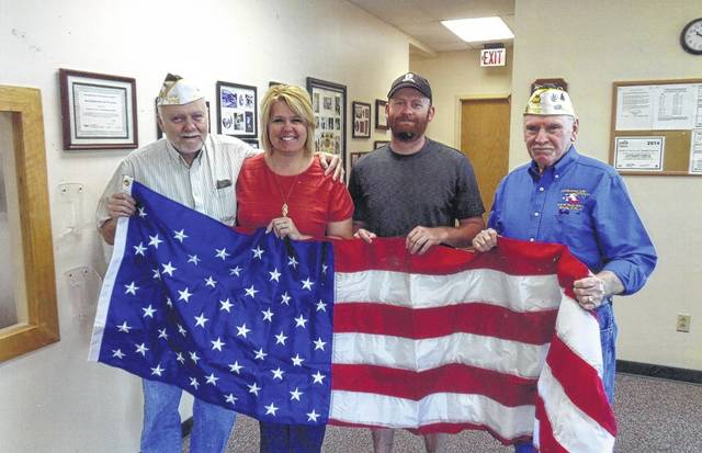 The VFW Post 3762 recently donated a flag to Fayette Progressive Industries. Pictured (L to R): Bob Malone, Betty Reisinger, Tim Stewart and Tom Smith.