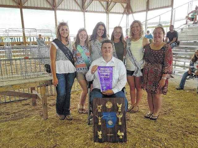 Dylan Page (seated) was named the 2017 Overall Small Animal Showman of Showmen Saturday afternoon. Page is pictured with (L to R): Fayette County Fair Queen Marissa Sheets, 2017 Small Animal Queen Abigail Riley, Fair Queen Attendants Susanna Eckstein, Skylynn Barden and Clare Sollars, and 2017 Horse Queen Taylor Perkins. Check out more coverage of the 2017 Showman of Showmen competition online at recordherald.com.