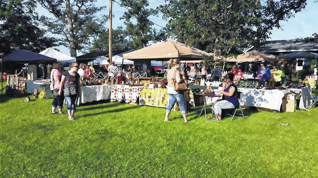 The annual event will be held at the home of Becky and Max Corns at 6685 Boyd Road. Becky said that there is no admission to the event and that there are necessary facilities located around the sale, including bathrooms. The sale will start at 9 a.m. on Saturday, Aug. 5 and will remain open until 6 p.m. Then on Sunday, Aug. 6 it will open from 11 a.m. until 4 p.m. Pictured are vendors and buyers from last year's event.