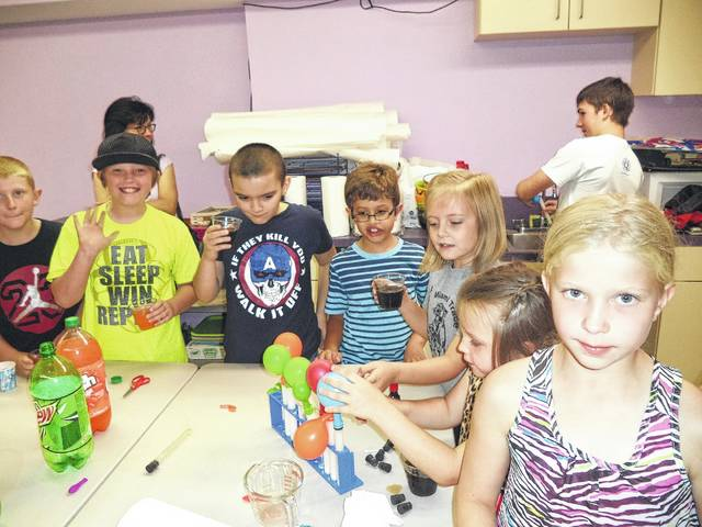 Kids enjoy the Mad Science Program at the library.