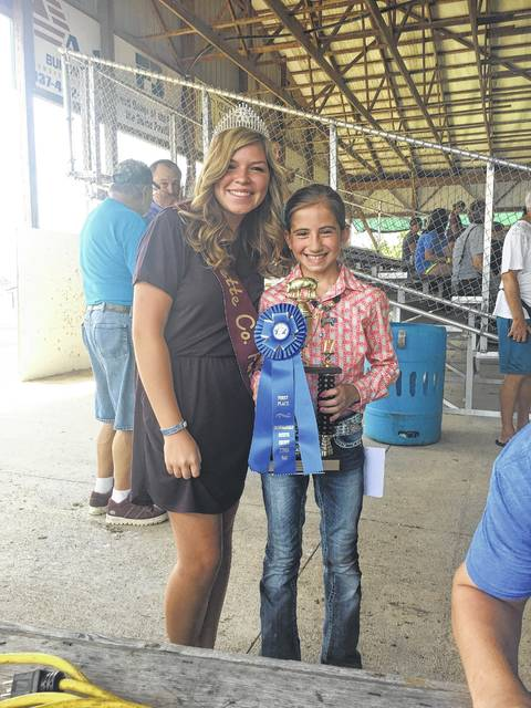 The Fayette County Junior Fair Swine Breeding Show was held Tuesday. Junior Breeding Showmanship Champion, Emily Reeves (right), with Fayette County Pork Queen Kendal May.