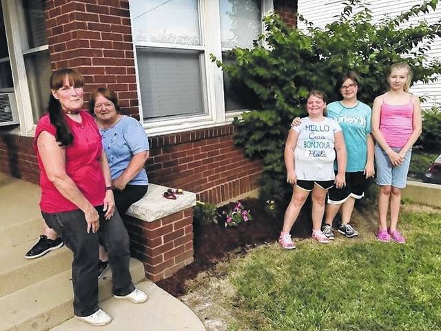 Pictured ( L to R) after planting is Modern Woodmen Member Debra Grover, Brick House Coordinator Gaye Huffman, Scouts: Ashley Wagner, Halie Wagner, and Allison Clay.