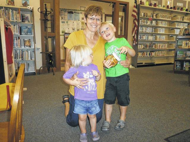 Sandy Parker (shown here with Hensley and Cole) was the most recent winner of Susan's Secret Sweets at Jeffersonville Branch Library. She guessed the correct number of goldfish in the goldfish jar. Congratulations Sandy.