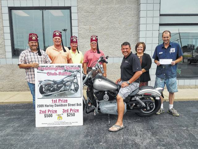 The Washington Shrine Club recently gave away a 2009 Harley Davidson Street Bob as part of a raffle to raise money for the club and the Shriner Hospital. Pictured (L to R): Washington Shrine Club President Keith Lippert, member Sonny Kearns, treasurer Steve Simpson, member Benny Jamison, motorcycle winner Brian Karnes, third place $250 prize winner Whitney Gentry and second place $500 prize winner Shannon Anthony.