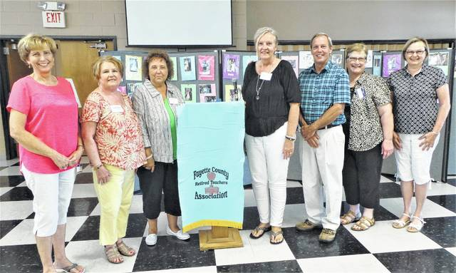 "Three new retirees from the Miami Trace and Washington schools were welcomed heartily at the August meeting of the Fayette County Retired Teachers Association, when some 50 members gathered in Grace United Methodist Church's Fellowship Hall for a picnic-style supper catered by The Willow. Shown are (from left) new retiree Carol Waddle and her ""picnic buddy"" Cathy White; FCRTA President Susan Stuckey; ""picnic buddy"" Elise Garringer with new retiree Jeff Sagar; and new retiree Carolyn Puckett with her ""picnic buddy"" Linda Hiser."