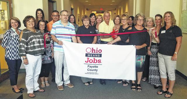 OhioMeansJobs Fayette County was recently welcomed as a new member of the Fayette County Chamber of Commerce by the Chamber's ambassador team. Cutting the ribbon are John Joy, dean of workforce development and community services at SSCC, and Faye Williamson, director of the Fayette County Department of Job and Family Services.