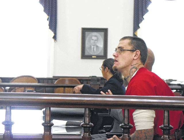 Jeffrey Ryan Holsinger, charged with the Fourth of July murder of Steve Mottie Jr., sits in court Tuesday for an arraignment.