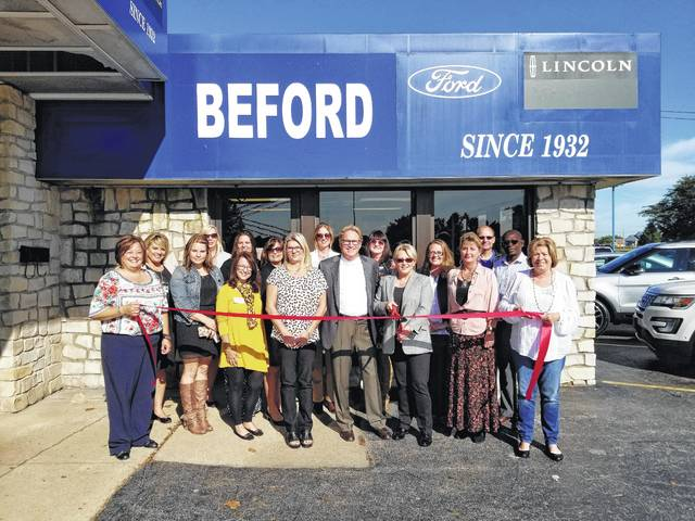 Owners of Beford Ford Lincoln are joined by the Fayette County Chamber of Commerce Ambassador Team as they cut the ribbon on the new dealership, located at 1700 Columbus Ave. in Washington C.H. Mark Beford (center), wife Connie (right) and their daughter Missy Meacham (left).