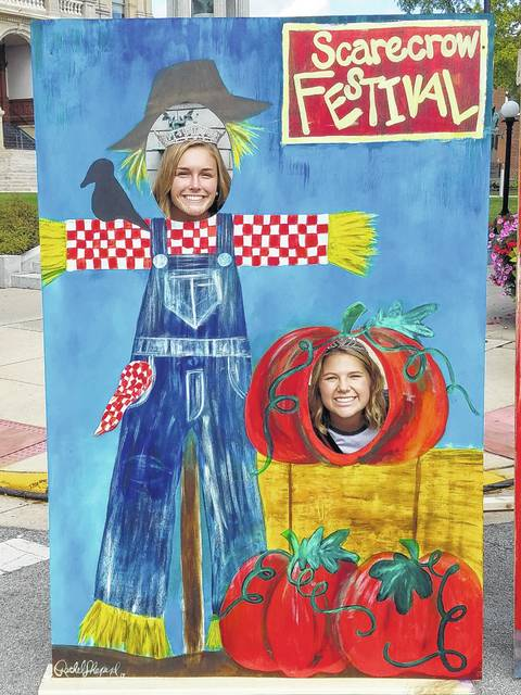 The Scarecrow Festival opened Friday in downtown Washington C.H. Scarecrow Festival Queen Tori Evans (left) and the second runner-up Abbi Pettit (right) welcomed guests to the festival Friday afternoon.