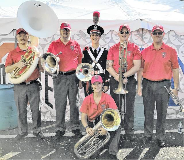 One family and six players participated in the Ohio State University marching band halftime show recently. From left to right, Stephen Essman, James Essman, Nathan Stevens, Dan Stevens, Brian Stevens; and kneeling, Julia Essman Stevens.
