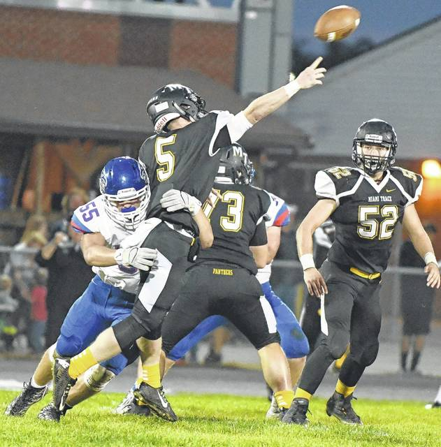 Miami Trace quarterback Brandon Arledge (5) releases the ball as he is hit by a Clinton-Massie defender during a non-conference game against the Falcons Friday, Sept. 15, 2017 at Miami Trace High School.