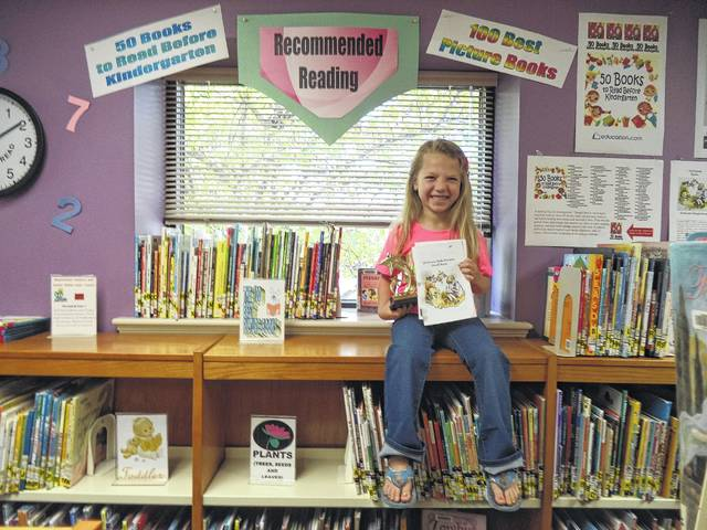 Carnegie Public Library is proud to introduce Ellie Hay, the most recent young reader to read all 100 of Anita Silvey's 100 Best Books for Children. Ellie, shown here with her trophy, and her family have read these 100 books and many other selections. To discover these and other great books, or for information about the 100 best children's books, please visit the children's department at Carnegie Public Library.