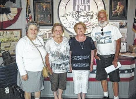 Some Fayette County Genealogical Society members at the Mott's Military Museum, from left to right, Phyllis Rankin, Sue Gilmore, Cathy White and Glenn Rankin.