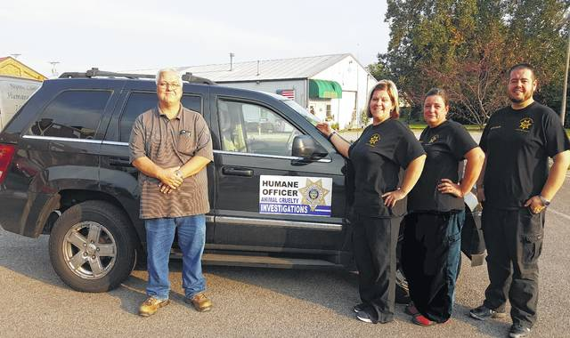 The Fayette Humane Society recently received the donation of a vehicle from the new board president Stacy Wills, Eitel's Towing owner out of Orient. Also pictured are humane officers Danyel Bageant, Bobbi Honicker and Brad Adams.