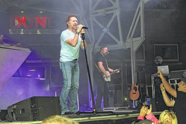 """Country music star Craig Morgan filled the streets of downtown Washington Court House with the sounds of his hit songs on Saturday evening on Main Street during the 2017 Scarecrow Festival. Some residents waited hours to get a perfect spot for the show as the street was filled from side to side with viewers of all ages. According to city officials, close to 5,000 people attended the annual festival over a three-day period. According to Mekia Rhoades, Main Street Committee president, the festival was bigger and better this year with more vendors, more food and great entertainment. Washington C.H. City Manager said the festival was """"extremely successful."""""""