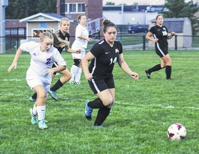 Washington's Arianna Heath (2) races Miami Trace's Aubrey Schwartz to the ball during a Frontier Athletic Conference match at Washington High School Tuesday, Sept. 19, 2017. Also pictured are (l-r); Cassidy Lovett of Miami Trace, Hannah Patterson of Washington and Jordan Bernard of Miami Trace.